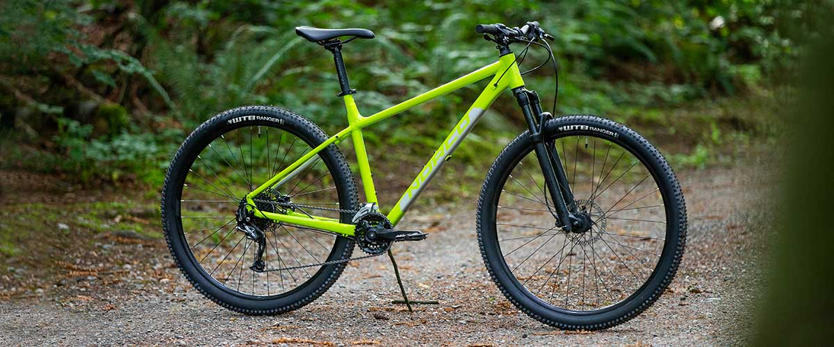 Side View of Yellow Norco Storm 1 Hardtail Mountain Bike