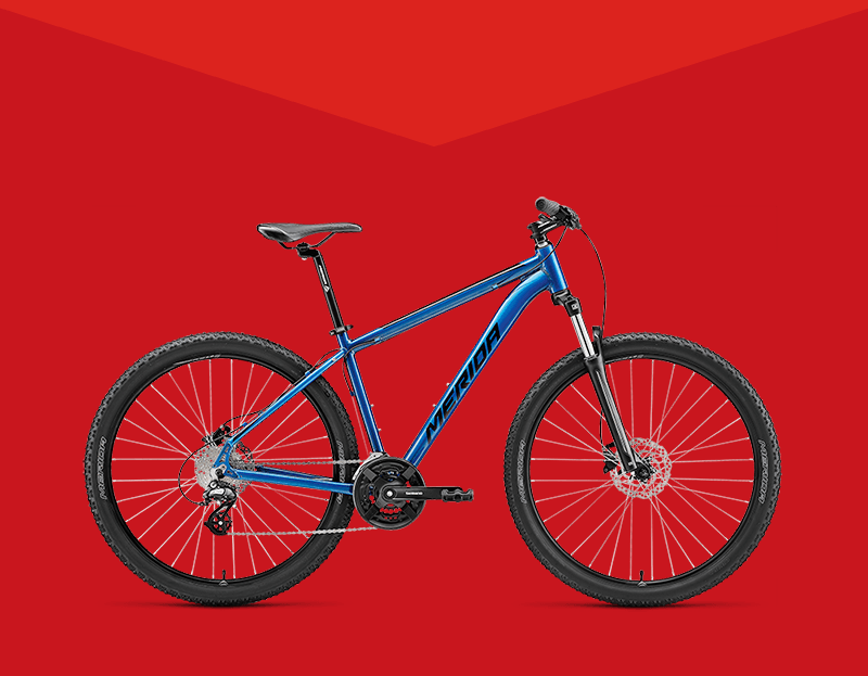 Non-brand bike shown with Blue Merida Hardtail Mountain Bike